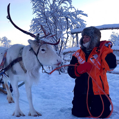 Michaela Stith standing next to reindeer